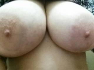 I'd love to be sucking on those amazing tits while you rode my throbbing hard cock!