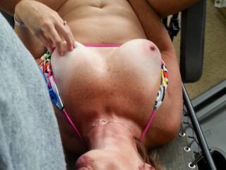 Reclining in her lounge chair sucking my cock
