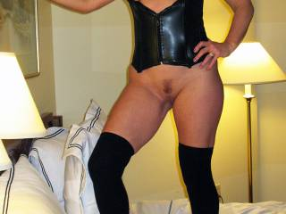 Just posing in leather and showing my trimmed pussy.