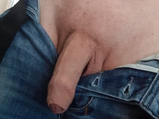 My uncut dick out my jeans.