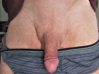 Pulling it out of my undies to show a smooth cock.