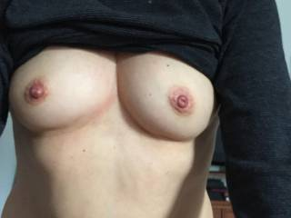 Sexy boobs,love those hard pretty nipples . want to suck them and cover them in my precum