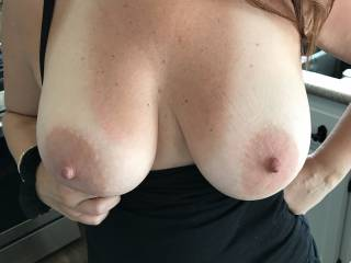 Came down for morning coffee to these tits out.  Love her showing me her tanlines, she knows they drive me wild.