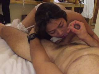 My hot Asian wife enjoying first time sucking and licking white cock and balls.