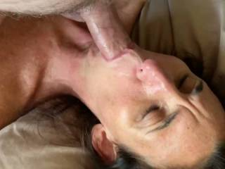 I slowly fuck her mouth and then have my balls licked. This made me hard watching it as I downloaded the video!