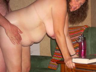 leaning on the coffee table taking some cock