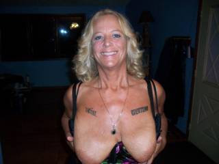 Wonderful tits, really...  I could slap those wonderfully plump beauties with my hard cock like there's no tomorrow... And empty my huge set of full balls onto them. I would get you thoroughly splattered and drenched in hot cum, no doubt about it.  I wonder if you like the idea?