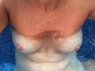 My wife's sexy tan line tits in the pool...
