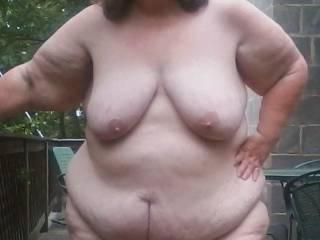 Posing naked outside in public