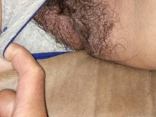 Pulling my wife\'s thong panty aside to show her yummy hairy pussy before our friend came back.