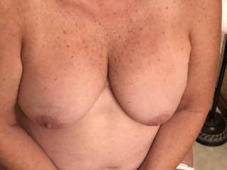 Showing me her nice mature tits.