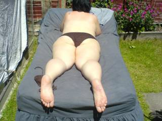 sunbathing topless in the garden would you like me to do more ???