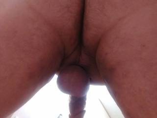 A shot from the backside before it got hard. Wish I had someone to help me out and fill my tight ass with there hard cock!