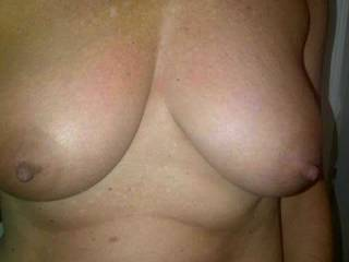 my wife\'s beautiful tanned breasts