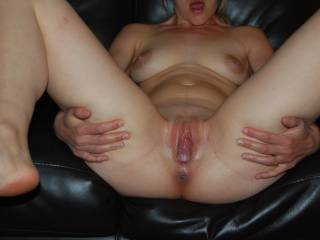 All spread and someone dropped a creampie in my woman\'s pussy. It also looks like her ass might have been used also. Makes me so fn hard knowing she was so naughty.