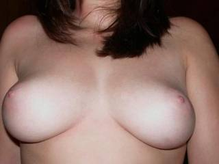 Beautiful tits, so round and nice pink nipples to play with too.