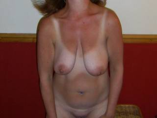 Love the hair in motion and those sexy tan lines. Sexy!!! Please post more.  Your pic is HOT. XOXOXOXOX Penelope and Dee