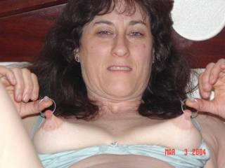 Pulling on my pierced nipples