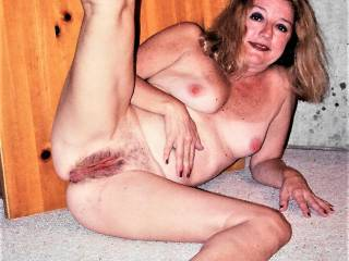 Naked again with my leg wide open to show my cunt. Wide open for you!!!