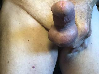 Squeezing my ridged cock and balls.