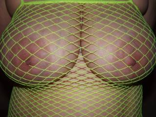 Simply exquisite... Love those gorgeous nipples poking through the fishnet. I want to reach out and give them a nice firm pinch.