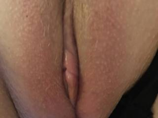 My wife's clean shaved pussy just before she used her huge dildo on it, she like it when I cum on her pussy whilst she fucks her dildo and teasing that it's a real guy fucking her