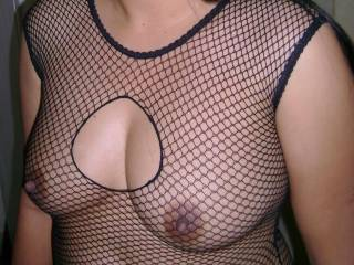 I'd love to tongue-tease those nips right through the fishnet.