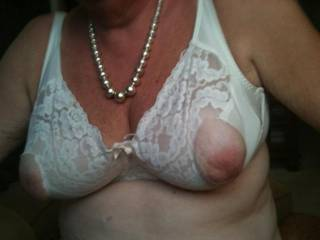 God would I ever be pleased to do that for her love this picture of her sexy nipples thru the bra drives me crazy