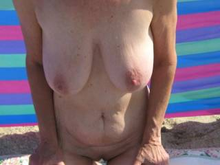 Such an exquisite woman showing your gorgeous hot body so erotically on the beach sure to have all the guys rods throbbing hard and ladies pussies drippin wet veiwing such a sensuous hot body!!!!