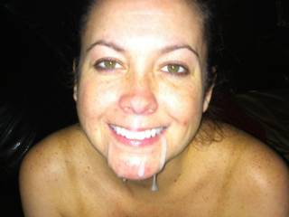 damn she is hot!.....looks sexy with cum dribbling down her chin too!