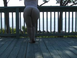 Lovely setting, how hot was it there? I bet the crease of your ass is sweaty and musky, smelling and tasting so sweet and divine. Would you stand there while i kneel behind you and worship your heavenly big thighs and butt?