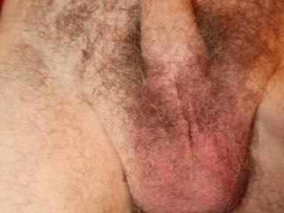 Lifting up my flaccid dick reveals my balls.