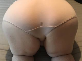 Wife bent over after after being fucked from behind. The wet patch is my cum leaking out