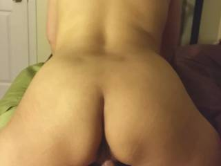 Wife riding reverse cowgirl.  I love it when her ass bounces up and down on my cock.
