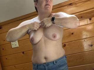 "Just ""accidentally"" showing off my boobs and navel piercing by the window to the landscapers in my backyard...thinking about getting more piercings… Should I get my nipples done next, or maybe my pussy?"