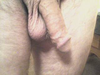 What would you do if he was standing in front of you naked, his cock and balls hanging out like this???? This is my view and I enjoy this everyday,  I\'m so thankful for him, he\'s a wonderful man.