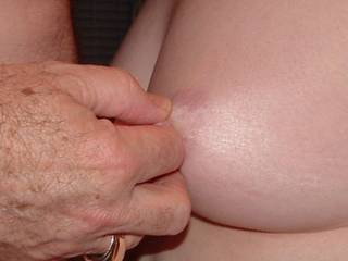 Tugging on her nipple...it\'s hard