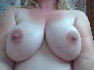 What do I think?...I think you have some amazing tits...I think I'd like to suck on your nipples....I think I'd love for you to suck my cock so I could shoot a nice warm load all over your beautiful tits. :)