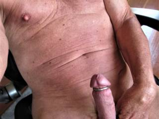 I put lots of hardware on my cock and balls.... showing it off.