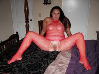 Hot thick ass milf dressed up in a red body stocking.