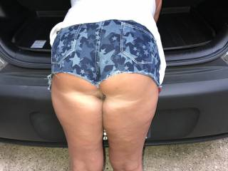booty shorts bent over car
