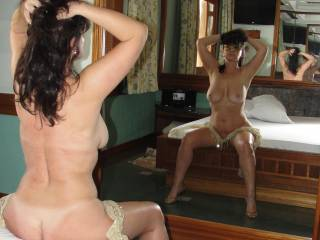 naked female body shown using resources of reflection in the mirror
