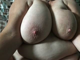 Close up of the playmate's big  tits