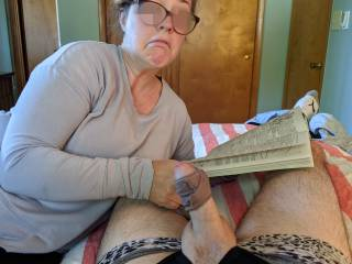 I think my hard cock finally got her attention. Looks like she might take her nose out of that book and put it on my cock.
