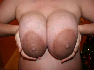 Thanks for all the awesome comments on my last preggo tits pic! I didn\'t realize how popular it would be, so here is another for you. My areolas are getting darker in this one.