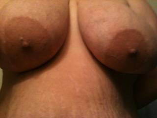 I could lick and suck those sexy breasts for hours to please you.