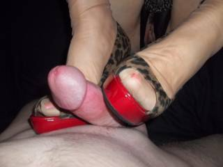 WOULD YOU LIKE MY HOT HEELS WRAPPED AROUND YOUR COCK TOO?