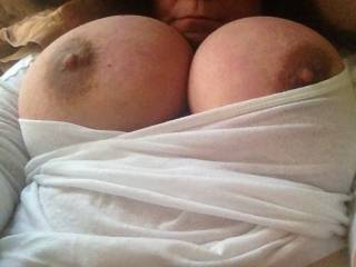 I would rip that shirt off, suck those big nipples, shot a load of warm sticky cum on them and lick it all off.  then play with your sexy body