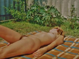 My wife nude sunbathing in my garden