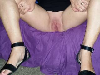 Spreading my legs , and showing my partners  friend my pussy,  and very erotic and naughty. I know now he wants to fuck me..! .